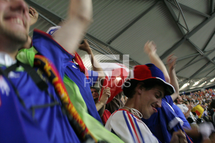 French National soccer team supporters cheer in Hannover FIFA World Cup stadium after France scored a goal during France and Spain's  second round FIFA World Cup match in Hannover, Germany  on Tuesday, June 27th 2006.  France defeated Spain 3-1.