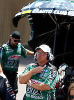 Jul. 20, 2014; Morrison, CO, USA; Crew chief Jimmy Prock for NHRA funny car driver John Force during the Mile High Nationals at Bandimere Speedway. Mandatory Credit: Mark J. Rebilas-
