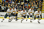 16 November 2008: University of Vermont Catamount forward Peter Lenes (3), a Senior from Shelburne, VT, leads the team back to the bench after a goal by defenseman Josh Burrows (22), a Sophomore from Prairie Grove, IL, in the first period against the Merrimack College Warriors at Gutterson Fieldhouse, in Burlington, Vermont. The Catamounts defeated the Warriors 2-1 in front of a near-capacity crowd of 3,813...Mandatory Photo Credit: Ed Wolfstein Photo
