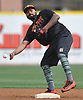 Elmer Reyes #13, Long Island Ducks infielder, throws to first base during a team workout at Bethpage Ballpark in Central Islip, NY on Friday, April 14, 2017.