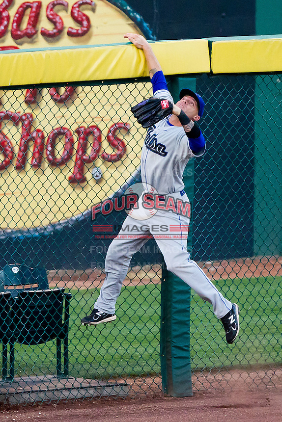 Scott Beerer (15) of the Tulsa Drillers jumps up the left field wall during a game against the Springfield Cardinals at Hammons Field on July 20, 2011 in Springfield, Missouri. Springfield defeated Tulsa 12-1. (David Welker / Four Seam Images)
