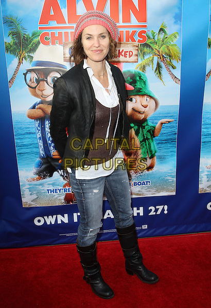 "Amy Brenneman.The Twentieth Century Fox Home Entertainment's ""Alvin And The Chipmunks: Chipwrecked"" Blu-ray And DVD Release Party Held At The El Rey Theatre, Los Angeles, California, USA..March 26th, 2012.full length jeans denim black jacket brown top hat boots orange.CAP/ADM/FS.©Faye Sadou/AdMedia/Capital Pictures."