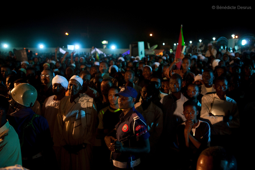 26 april 2010 - Karthoum, Sudan -Flag waving NCP supporters gathered at the party's Khartoum headquarters. Sudan's President Omar al-Bashir won another term in office Monday, according to election officials, with a comfortable majority (68 percent of the vote ) in elections marred by boycotts and fraud allegations, becoming the first leader to be elected while facing an international arrest warrant for alleged crimes he orchestrated in the western region of Darfur. The elections take place as Sudan heads toward a referendum in eight months that could lead South Sudan to split off and become Africa's newest nation. Photo credit: Benedicte Desrus