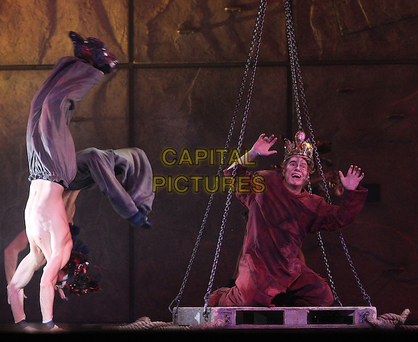 Matt Laurent.'Notre Dame de Paris' musical premiere in Crocus City Hall. Moscow, Russia  31st October 2012.on stage acting full length crown red robe kneeling hands arms in air .CAP/PER/VV.© VV/Persona/CapitalPictures