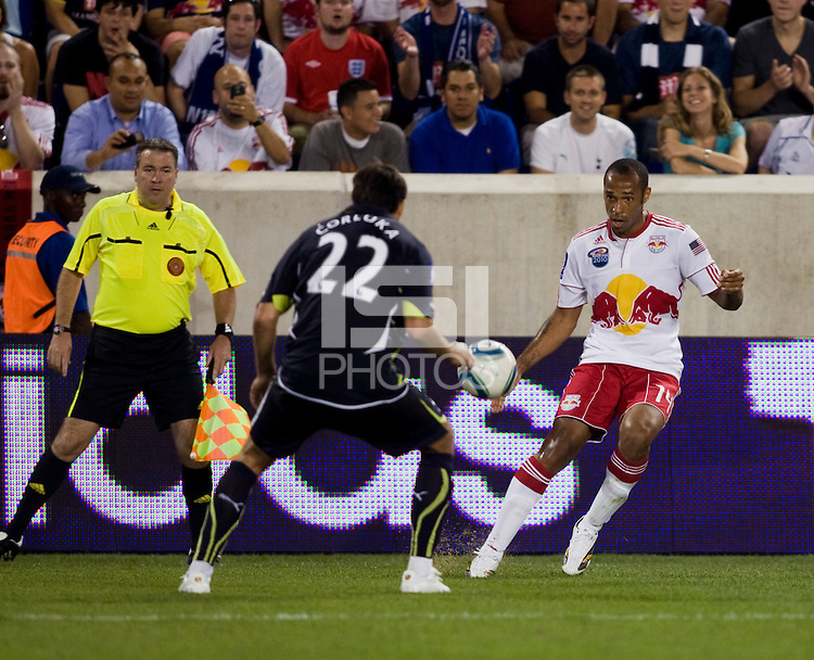 Thierry Henry, Vedran Corluka. Tottenham defeated the New York Red Bulls, 2-1.