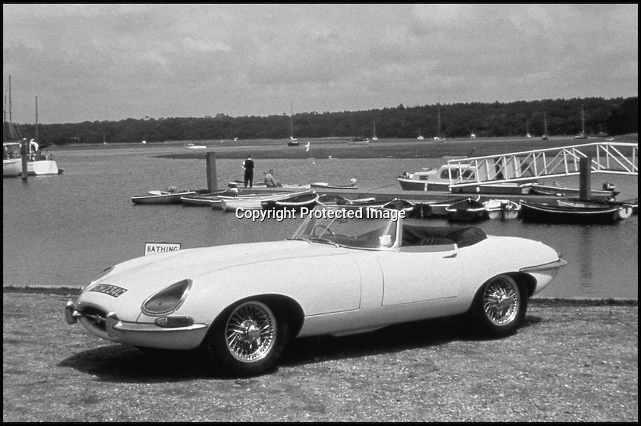 "BNPS.co.uk (01202 558833).Pic: GoogleImages..1960's advertising for the revolutionary E-Type.....Birth of a legend - rediscovered in a dusty old barn...One of the earliest E-Type Jaguars still in existance has been uncovered in a Somerset barn...Although not exactly in showroom condition the 1961 convertible was only the 59th E-Type to be built, and experts reckon it is one of only a handful to survive from the earliest days of the iconic British motor...The completely original car has been languishing in the barn near Bath for over 30 years after the running costs became to much for its owner...On its launch in 1961 even fierce rival Enzo Ferrari described the E-Type as ""the most beautiful car ever built"" and they soon became celebrated for their sleek design and top speed of 150mph...Although this historic car has an estimate of £30,000 at auction it will take the proud new owner at least another£50,000 to restore it to its former glory - but then the almost unique car will be worth at least £120,000."