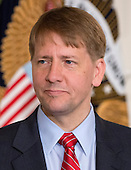 Richard Cordray, new Director of the Consumer Financial Protection Bureau listens as United States President Barack Obama (not pictured) delivers a statement on Cordray's confirmation in the State Dining Room of the White House in Washington, D.C.onWednesday, July 17, 2013. <br /> Credit: Ron Sachs / Pool via CNP