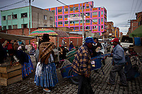 Street fair and local arquitecture.Just 25 years ago it was a small group of houses around La Paz  airport, at an altitude of 12,000 feet. Now El Alto city  has  nearly one million people, surpassing even the capital of Bolivia, and it is the city of Latin America that grew faster ...It is also a paradigmatic city of the troubles  and traumas of the country. There got refugee thousands of miners that lost  their jobs in 90 ¥s after the privatization and closure of many mines. The peasants expelled by the lack of land or low prices for their production. Also many who did not want to live in regions where coca  growers and the Army  faced with violence...In short, anyone who did not have anything at all and was looking for a place to survive ended up in El Alto...Today is an amazing city. Not only for its size. Also by showing how its inhabitants,the poorest of the poor in one of the poorest countries in Latin America, managed to get into society, to get some economic development, to replace their firs  cardboard houses with  new ones made with bricks ,  to trace its streets,  to raise their clubs, churches and schools for their children...Better or worse, some have managed to become a sort of middle class, a section of the society that sociologists call  emerging sectors. Many, maybe  most of them, remain for statistics as  poor. But clearly  all of them have the feeling they got  for their children a better life than the one they had to face themselves .
