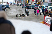 Lachlan Clarke mushes into the finish chute on Front Street in Nome during the 2010 Iditarod
