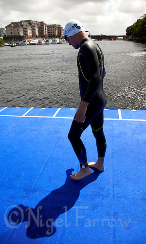 04 JUL 2010 - ATHLONE, IRL - Tom Bishop (GBR) prepares for the start of the European Junior Mens Triathlon Championships .(PHOTO (C) NIGEL FARROW)