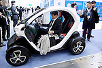 "December 13, 2012, Tokyo, Japan - A visitor tests the Nissan New Mobility car. The Eco-Products Exhibition is one of the biggest environmental issues in Japan, drawing more than 180,000 business people and consumer exhibitors. The theme of this year is ""The Greener, The Smaller - The Future We Will Choose"", the exhibition will be held from December 13th to 15th in Tokyo Big Sight.(Photo by Rodrigo Reyes Marin/AFLO).."