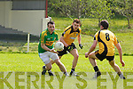 Knocknagoshal's Dan Roche sidesteps Con Carmody and Padric Rudell of Asdee last Sunday afternoon in Asdee