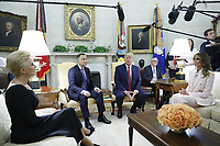(L-R) Polish First Lady Agata Kornhauser-Duda, Polish President Andrzej Duda, US President Donald J. Trump and First Lady Melania Trump during a meeting in the Oval Office of the White House in Washington, DC, USA, 12 June 2019. Later in the day President Trump and President Duda will participate in a signing ceremony to increase military to military cooperation including the purchase of F-35 fighter jets and an increased US troop presence in Poland. Credit: Shawn Thew/CNP/AdMedia