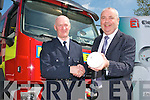 Tom Meehan (Technical Sales Manager) with Ei Electronics and Vincent Hussey (Acting Chief Fire Officer Kerry County Council) at Tralee Fire Station on Thursday. Ei Electronics is giving 100 free smoke alarms to all the fire services around the country in response to a high volume of deaths caused by fires in the recent months. Ei Electronics is a 100% Irish Owned company and wants ti give something back to the community.