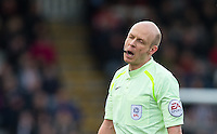 Referee Nick Kinseley eyes closed during the Sky Bet League 2 match between Grimsby Town and Wycombe Wanderers at Blundell Park, Cleethorpes, England on 4 March 2017. Photo by Andy Rowland / PRiME Media Images.