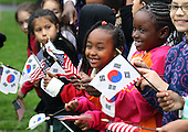 Children await the start of an arrival ceremony for President Lee Myung-bak of the Republic of Korea at the White House hosted by United States President Barack Obama, Thursday, October 13, 2011 in Washington, DC. Later in the day Lee is scheduled to hold a joint press conference with Obama and also address a joint meeting of Congress. .Credit: Alex Wong / Pool via CNP
