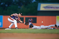 Aberdeen Ironbirds second baseman Drew Turbin (32) waits for a throw as Aaron Mizell (8) slides into second during a game against the Tri-City ValleyCats on August 6, 2015 at Ripken Stadium in Aberdeen, Maryland.  Tri-City defeated Aberdeen 5-0 in a combined no-hitter.  (Mike Janes/Four Seam Images)