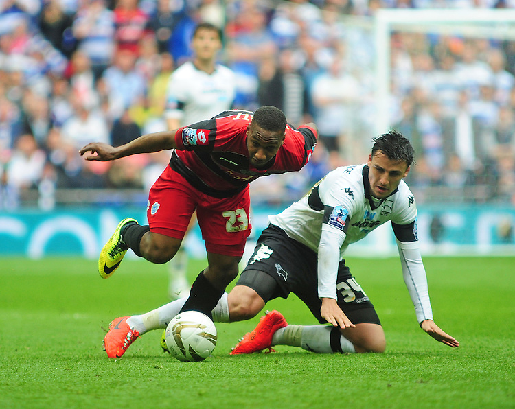Queens Park Rangers' Junior Hoilett vies for possession with Derby County's George Thorne<br /> <br /> Photographer Chris Vaughan/CameraSport<br /> <br /> Football - The Football League Sky Bet Championship Play-Off Final - Derby County v Queens Park Rangers - Saturday 24th May 2014 - Wembley Stadium - London<br /> <br /> &copy; CameraSport - 43 Linden Ave. Countesthorpe. Leicester. England. LE8 5PG - Tel: +44 (0) 116 277 4147 - admin@camerasport.com - www.camerasport.com