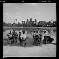 Angkor Wat, Siem Reap, Cambodia - Young women prepare to have their photos taken in front of Angkor Wat, December 2017.