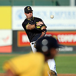 SIOUX FALLS, SD - JUNE 19 Shelby Ford #3 from the Sioux Falls Canaries throws to first as Omar Luna #24 from the Amarillo Sox runs to first in the first inning Thursday night at the Sioux Falls Stadium. (Photo by Dave Eggen/Inertia)
