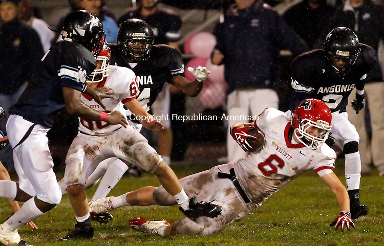 Ansonia, CT- 15, October 2010-101510CM07 Wolcott's Jake Petillo dives for extra yardage against Ansonia defenders, Raeshaun Finney(left), Hezekiah Duncan (back) and Arkeel Newsome (#2). Helping to block is teammate, Jim Nelson (#66)Friday night in Ansonia.  Chargers went onto win, 39-20.  Christopher Massa Republican-American
