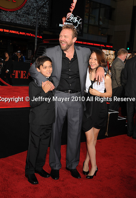 """HOLLYWOOD, CA. - June 03: Director Joe Carnahan and children arrive at """"The A-Team"""" Los Angeles premiere held at Grauman's Chinese Theatre on June 3, 2010 in Los Angeles, California.c"""