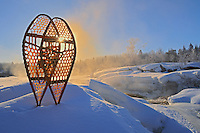 Snowshoes by Pinawa River at sunrise <br /> Pinawa<br /> Manitoba<br /> Canada