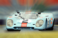 A Gulf Porsche 917 races during a vintage sports car event at Daytona INternational Speedway, Daytona Beach, FL.  Image has been digitally manipulated in Photoshop.  (Photo by Brian Cleary/www.bcpix.com)