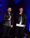 MIAMI, FLORIDA - NOVEMBER 02: Enrique Santos and Sabastian Villalobos on stage at the 2019 iHeartRadio Fiesta Latina at AmericanAirlines Arena on November 2, 2019 in Miami, Florida.  ( Photo by Johnny Louis / jlnphotography.com )