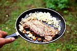 Alaska: Dinner at Trail Lake. Photo akaway104..Photo copyright Lee Foster, 510/549-2202, lee@fostertravel.com, www.fostertravel.com