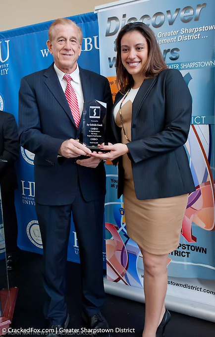 Greater Sharpstown board member, Steve Moore presents award to Isy Gabriela Conde