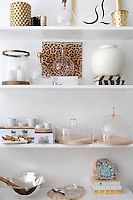 modern ornaments on white shelves Get A Room is a boutique in Scarsdale New York for interior design.
