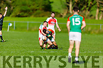 Kilcummin's Damien O'Leary putting pressure on Mike Breen of Mid Kerry in the County Football championship game in Killorglin on Sunday.