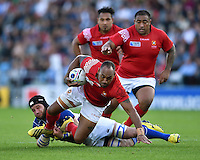 Vunga Lilo of Tonga is tackled to ground. Rugby World Cup Pool C match between Tonga and Namibia on September 29, 2015 at Sandy Park in Exeter, England. Photo by: Patrick Khachfe / Onside Images