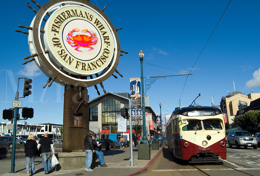 Famous Fisherman Wharf with old street car and horse carriage in tourist section of San Francisco and sign to welcome tourist