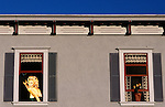 Side of apartment building with a painting of Marilyn Monroe in the window and fower pot in window painting Fort Bragg California USA