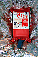 Fire blanket. This is a flame retardant sheet that is used to cover containers whose contents have ignited. By laying the blanket over the container, oxygen is starved therefore extingishing the contents...© SHOUT. THIS PICTURE MUST ONLY BE USED TO ILLUSTRATE THE EMERGENCY SERVICES IN A POSITIVE MANNER. CONTACT JOHN CALLAN. Exact date unknown.john@shoutpictures.com.www.shoutpictures.com.