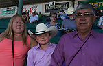 """Rose and Herb Glazier with 7-year-old grandson Kai during Purple Night at the Rodeo on Tuesday night, June 21, 2016.  """"Man Up Crusade Night"""" encouraged rodeo goers to wear purple for advocacy to stop domestic violence."""