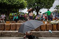 Local residents queue for gas distribution as shortages of gas supply continue after weeks of blockades, in Shinahota town, Chapare region, Bolivia. December 02, 2019.<br /> Des résidents locaux font la queue pour la distribution du gaz, car les pénuries d'approvisionnement en gaz se poursuivent après des semaines de blocus dans la ville de Shinahota, dans la région de Chapare, en Bolivie. 2 décembre 2019.
