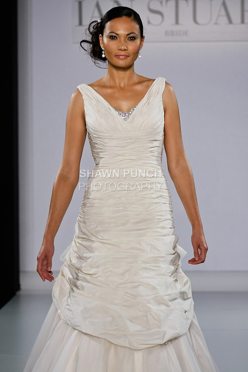 Model walks runway in a Serenade wedding dress from the Ian Stuart - Supernova Bridal Collection 2013 fashion show, at the Couture Show during New York Bridal Fashion Week, October 14, 2012.