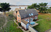 BNPS.co.uk (01202 558833)<br /> Pic: Albury&Hall/BNPS<br /> <br /> Sandpiper Cottage.<br /> <br /> Love Islands ? - Then this idyllic spot in the middle of Poole harbour in Dorset could be the perfect escape.<br /> <br /> 15 acre Round island has been put up for long term rent by its owners for £15,000 a month.