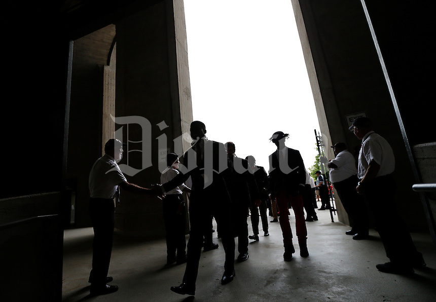 Ohio State Buckeyes running back Ezekiel Elliott (15) shakes hands with an usher as he makes his way into Ohio Stadium before the college football game between the Ohio State Buckeyes and the Northern Illinois Huskies in Columbus, Saturday afternoon, September 19, 2015. (The Columbus Dispatch / Eamon Queeney)