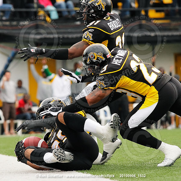 September 6, 2010; Hamilton, ON, CAN; Hamilton Tiger-Cats linebacker Markeith Knowlton (25) celebrates a blocked punt recovered for a touchdown with defensive backs Jykine Bradley (31) and Will Heyward (23). CFL football: Labour Day Classic - Toronto Argonauts vs. Hamilton Tiger-Cats at Ivor Wynne Stadium. The Tiger-Cats defeated the Argonauts 28-13. Mandatory Credit: Ron Scheffler.