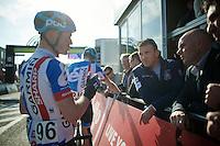 former rider/legend Johan Museeuw (BEL) listening to Nick Nuyens' (BEL/Garmin-Sharp) race recap at the finish<br /> <br /> 102nd Scheldeprijs 2014