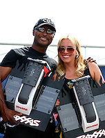 Aug. 31, 2013; Clermont, IN, USA: NHRA top fuel dragster driver Antron Brown (left) with Brittany Force at the Traxxas Shootout during qualifying for the US Nationals at Lucas Oil Raceway. Mandatory Credit: Mark J. Rebilas-