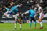 Fleetwood Town's Wes Burns tumbles over the back of Milton Keynes Dons' Scott Golbourne<br /> <br /> Photographer Andrew Kearns/CameraSport<br /> <br /> The EFL Sky Bet League One - Milton Keynes Dons v Fleetwood Town - Saturday 11th November 2017 - Stadium MK - Milton Keynes<br /> <br /> World Copyright &copy; 2017 CameraSport. All rights reserved. 43 Linden Ave. Countesthorpe. Leicester. England. LE8 5PG - Tel: +44 (0) 116 277 4147 - admin@camerasport.com - www.camerasport.com