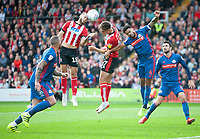 Lincoln City's Jorge Grant, left and Tyler Walker go up for a header with Sunderland's Jordan Willis<br /> <br /> Photographer Andrew Vaughan/CameraSport<br /> <br /> The EFL Sky Bet League One - Lincoln City v Sunderland - Saturday 5th October 2019 - Sincil Bank - Lincoln<br /> <br /> World Copyright © 2019 CameraSport. All rights reserved. 43 Linden Ave. Countesthorpe. Leicester. England. LE8 5PG - Tel: +44 (0) 116 277 4147 - admin@camerasport.com - www.camerasport.com
