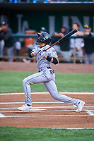 Eddy Diaz (14) of the Grand Junction Rockies bats against the Ogden Raptors at Lindquist Field on June 17, 2019 in Ogden, Utah. The Rockies defeated the Raptors 9-0. (Stephen Smith/Four Seam Images)