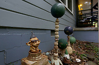The front yard of Kelly and Donna Muhollan, who are the folk music duo Still on the Hill, is decorated with a variety of spheres Friday, May 15, 2020, in Fayetteville. Their living room doubles as the Ozark Ball Museum. Check out nwaonline.com/200524Daily/ and nwadg.com/photos for a photo gallery.<br /> (NWA Democrat-Gazette/David Gottschalk)