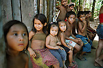 Children attending a birthday celebration at their village in a clearing in the rainforest by the Tapajos river. The Floresta Nacional do Tapajos (FLONA), a 6500 km2 protected reserve, was home to several small communities which lived on the banks of the Rio Tapajos river. Most communities did not have electricity or running water and access to the villages was by unpaved dirt roads from Santarem and Highway BR163.